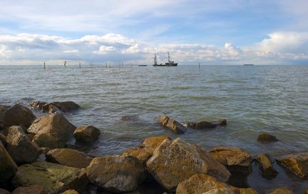 Commercial fishing on a lake along a dike photo