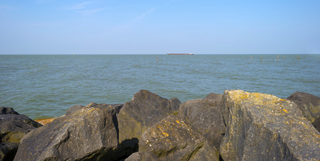markermeer: The shore of a dike in a lake in spring Stock Photo