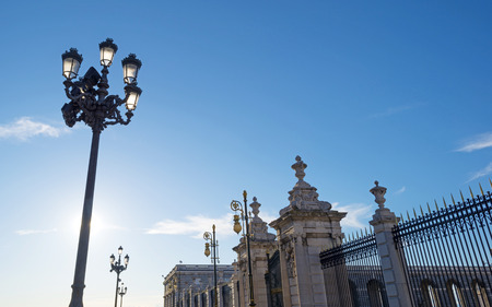 Lamppost in front of the Royal Palace in Madrid photo