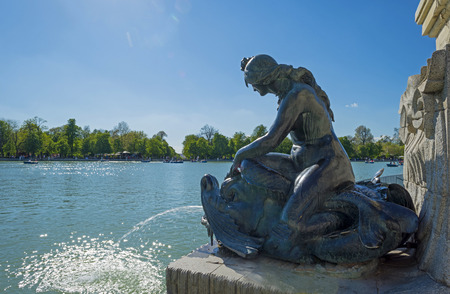 Statue along the Retiro Pond in Madrid photo