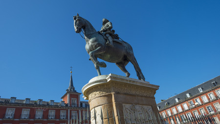 Equestrian statue on the Plaza Mayor in Madrid photo
