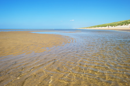 spring tide: North Sea along a sunny beach in spring Stock Photo