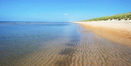 North Sea along a sunny beach in spring photo