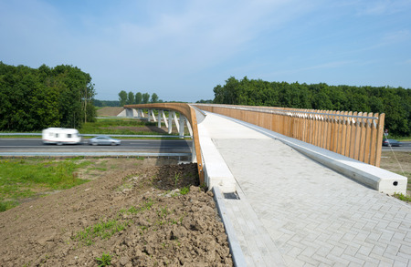 Just finished  bicycle bridge crossing an highway photo