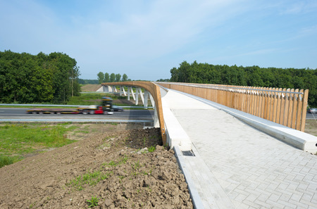 Just finished  bicycle bridge crossing a public highway photo