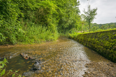 meandering: Stream meandering through the countryside