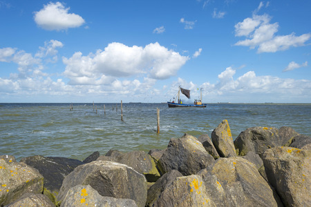 markermeer: Trawler fishing on a lake along a dike