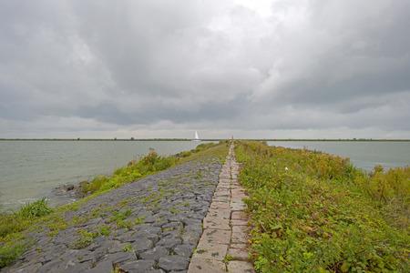 markermeer: Boat sailing on a lake under deteriorating weather