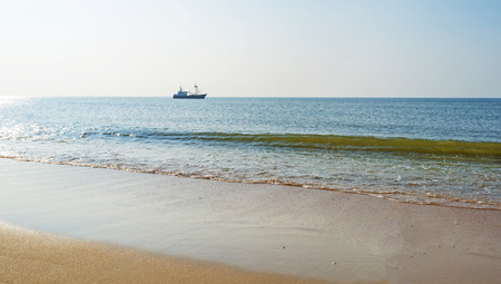 Trawler fishing in the North Sea in summer photo