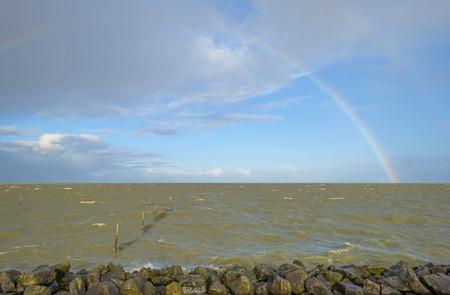 markermeer: Rainbow over the horizon of a sea