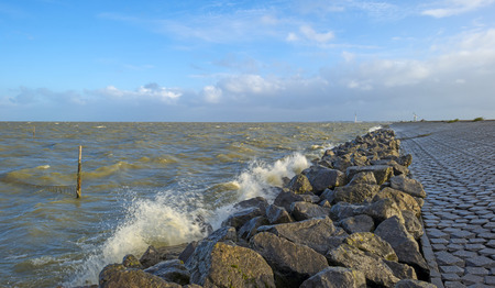 markermeer: Basalt stones along a dike in a stormy sea Stock Photo