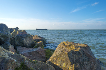 markermeer: Protecting basalt stones along a sea at fall Stock Photo