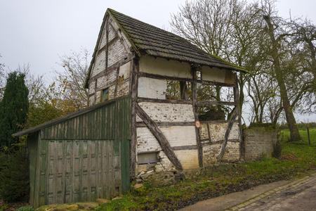 rundown: Rundown timbered house at fall