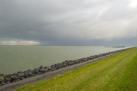 markermeer: Basalt stones along a lake protecting a dike