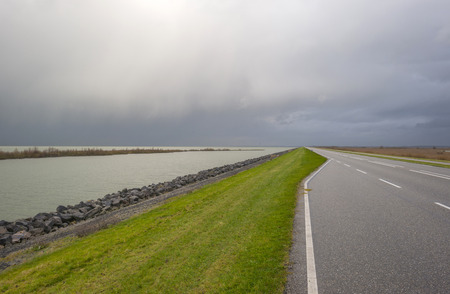 markermeer: Road on a dike along a lake in autumn Stock Photo
