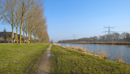 Footpath along a canal in winter photo