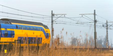 passenger train: Passenger train driving through nature in winter