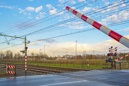 Rail crossing in a city in winter photo