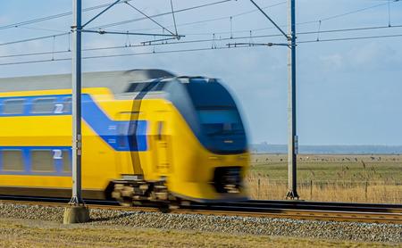 passenger train: Electric passenger train moving through nature