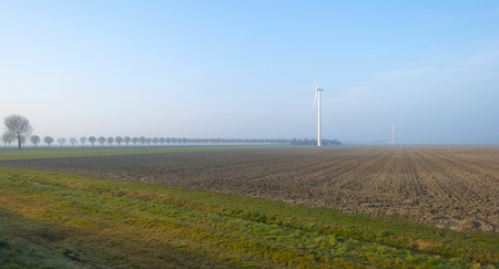 plowed field: Wind turbine in a plowed field in winter Stock Photo