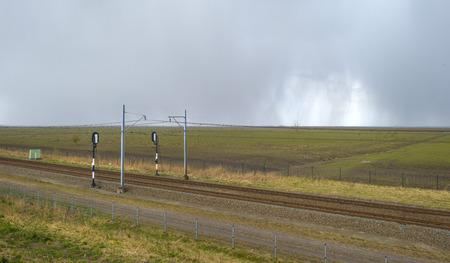 rain shower: Railroad through natureunder a rain shower in spring