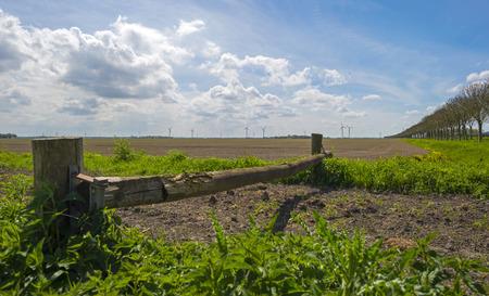 plowed field: Closed footpath along a plowed field in spring