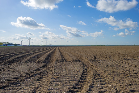 furrows: Plowed field with furrows in spring Stock Photo