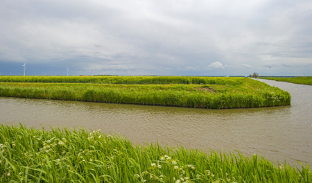 deteriorating: Canal through a rural landscape under deteriorating weather Stock Photo
