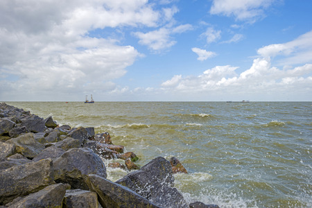 markermeer: Trawler fishing under a cloudy blue sky in spring Stock Photo
