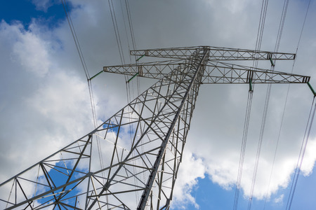 blue cloudy sky: Electric power transmisson in a blue cloudy sky
