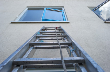 metier: Ladder against a wall for painting