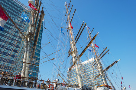 masts: Masts of a tall ship in the harbor of Amsterdam Editorial