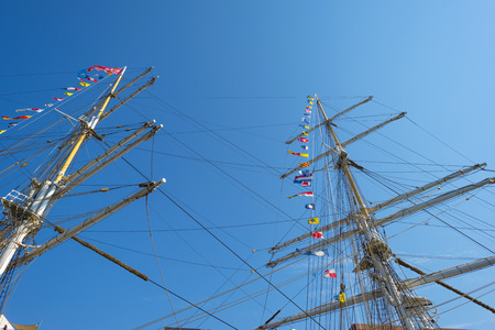 tall ship: Masts of a tall ship in the harbor of Amsterdam Stock Photo