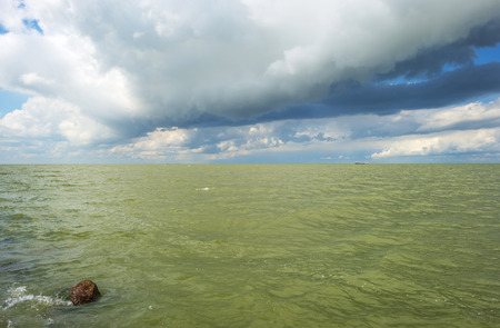 deteriorating: Deteriorating weather above a lake in summer