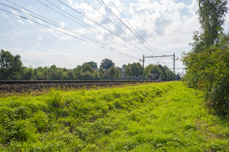 railway transportation: Railroad through the countryside in summer Stock Photo