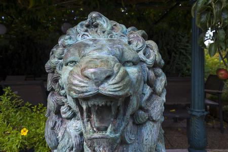 wildanimal: Vintage sculpture of a lion in a garden Stock Photo