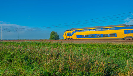 railway transportation: Train driving through nature in autumn