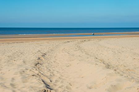 Blue sky on a beach along the North Sea Stock Photo