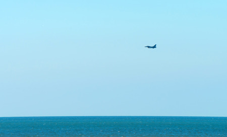 fighter: Military aircraft flying over the North Sea Stock Photo