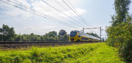 passenger train: Passenger train driving at high speed in summer