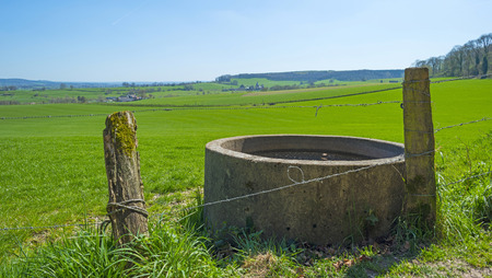 cistern: Cistern in a sunny meadow in spring Stock Photo