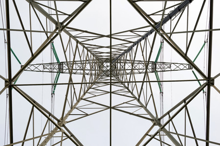 power line tower: Tower of a power line seen from below Stock Photo