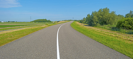 roadway: Center line of an uphill roadway in spring Stock Photo