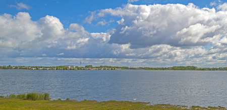lelystad: Residential area on the shore of a lake in spring