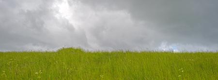 dike: Dike below a cloudy sky in spring