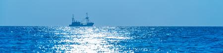trawler: Trawler fishing in moonlight at sea in autumn