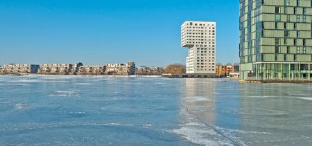 ice sheet: Highrise along a frozen lake in winter