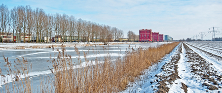 ice sheet: Highrise along a frozen canal in winter