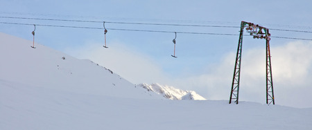 ski lift: Ski lift on a snowy slope in winter