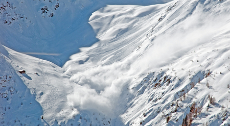 avalanche: Snow avalanche in the mountains in winter